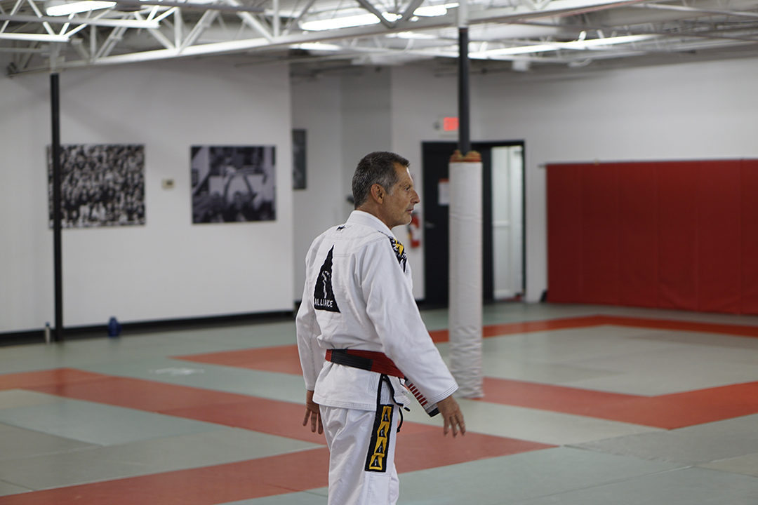 Jacare-serious-face-alone-on-mat
